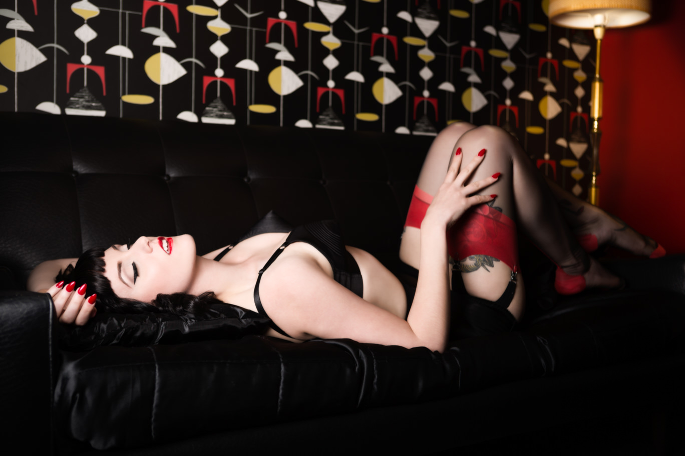 pinup girl in black lingerie boudoir photoshoot