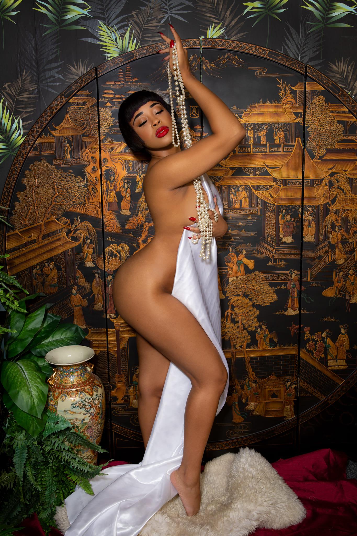 Model Posing in Vintage Oriental Themed Set